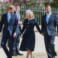 Le prince Harry, duc de Sussex, Peter Phillips et Autumn Phillips arrivent pour assister à la messe de Pâques à la chapelle Saint-Georges du château de Windsor, le 21 avril 2019.