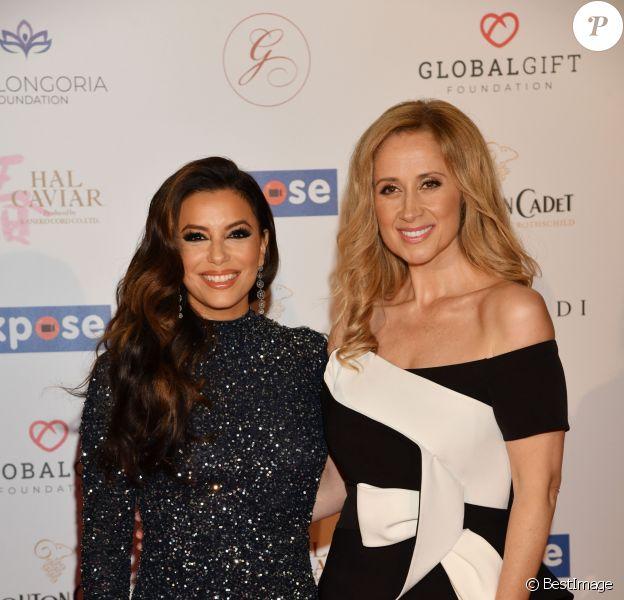 """Eva Longoria et Lara Fabian - Arrivées à la soirée """"Global Gift Gala"""" sur la Terrasse Mouton Cadet lors du 72ème Festival International du Film de Cannes. Le 20 mai 2019"""