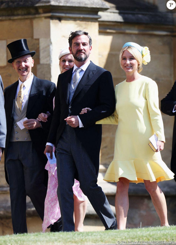 Izzy May, attachée de presse de David Beckham et ici au bras de Markus Anderson le 19 mai 2018 à Windsor lors du mariage de Meghan Markle et du prince Harry, est devenue l'une des plus proches confidentes de la duchesse de Sussex depuis son installation en Grande-Bretagne en 2017. © Chris Jackson/PA Photos/ABACAPRESS.COM