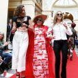 """La Baronne Astrid Ullens De Schooten entourée de sa petite fille Morgane De Halleux et de sa niéce Florence De Bueger - Défilé """"Over Fifty... et alors !"""" à la galerie Vivienne à Paris le 17 Juin 2019. C'est sous les ors de la galerie Vivienne que la styliste Nathalie Garçon, initiatrice de l'association """"Over fifty...et alors"""", a organisé un défilé de mode afin de faire évoluer la visibilité et le regard porté sur les femmes de plus de cinquante ans. © Dominique Jacovides/Bestimage"""