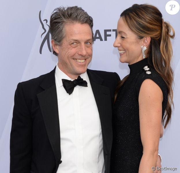 Hugh Grant et sa femme Anna Elisabet Eberstein - Photocall - 25ème cérémonie annuelle des Screen Actors Guild Awards au Shrine Audritorium à Los Angeles, le 27 janvier 2019.