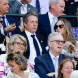 Hugh Grant et sa femme Anna Elisabet Eberstein (à gauche) - Les célébrités dans les tribunes lors de la finale de Wimbledon entre le serbe Novak Djokovic et le sud-africain Kevin Anderson à Londres, le 15 juillet 2018.