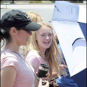 Dakota Fanning en combinaison intégrale et décolletée... la jeune actrice a bien grandi !
