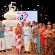 """Marc Toesca, Camille Gottlieb, le prince Albert II de Monaco, la princesse Stéphanie, Lane, le plus ancien des bénévoles de FAM, mis à l'honneur ce soir, avant son départ, Marie Chevallier et Louis Ducruet, son futur époux, entourés par les membres de l'association - Traditionnelle soirée au profit de Fight Aids Monaco, dans la salle des Etoiles du Sporting à Monaco le 13 juillet 2019. Cette année, l'association de la princesse Stéphanie de Monaco, fête ses 15 ans. C'est le célèbre groupe américain The Beach Boys, tout droit venu de Californie, qui assure le Show au profit de l'association. Les membres de la famille princière, le prince Albert II de Monaco en tête, ainsi que l'ensemble du public, n'ont pas hésité à se mettre en mode """"Beach Boys"""". © Bruno Bebert/Bestimage"""