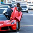 Exclusif - Travis Scott monte dans sa Ferrari rouge dans le quartier de West Hollywood à Los Angeles, le 22 juillet 2019.