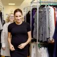 """Meghan Markle (enceinte), duchesse de Sussex, en visite dans les locaux de l'association """"Smart Works"""" à Londres. Le 10 janvier 2019  The Duchess of Sussex, walks through racks of clothes with Lady Juliet Hughes-Hallett, during her visit to Smart Works, in London, on the day that she has become their patron, as well as patron of the National Theatre, the Association of Commonwealth Universities, and the animal welfare charity, Mayhew.10/01/2019 - Londres"""