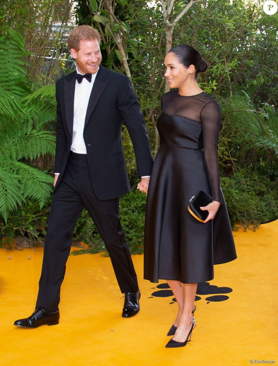 Meghan Markle, duchesse de Sussex, avec le prince Harry lors de la première du film Le Roi Lion au cinéma Odeon Luxe Leicester Square à Londres, le 14 juillet 2019.