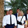 Emmanuel Macron, président de la République Française, et la Première dame Brigitte Macron (avec une attelle au bras droit) arrivent à la mairie de Bormes-les-Mimosas où ils sont accueillis par François Arizzi (maire de Bormes-les-Mimosas) lors de la cérémonie de commémoration du 75ème anniversaire de la libération de la ville de Bormes-les-Mimosas, le 17 août 2019. © Dominique Jacovides/Bestimage