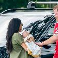 Le prince Harry, Meghan Markle, duchesse de Sussex, et leur fils Archie Harrison Mountbatten-Windsor lors d'un match de polo caritatif à Wokinghan en Angleterre le 10 juillet 2019.