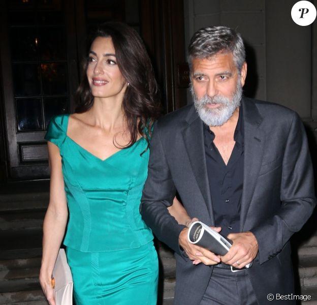 George Clooney et sa femme Amal Alamuddin Clooney à la sortie de la soirée caritative International Law benefit à The Frick Collection à New York, le 1er octobre 2019