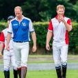 Le prince William, duc de Cambridge et son frère le prince Harry, duc de Sussex lors d'un match de polo de bienfaisance King Power Royal Charity Polo Day à Wokinghan, comté de Berkshire, Royaume Uni, le 10 juillet 2019.