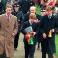Le prince Charles avec ses fils William et Harry pour la messe de Noël à Sandringham en 1997.