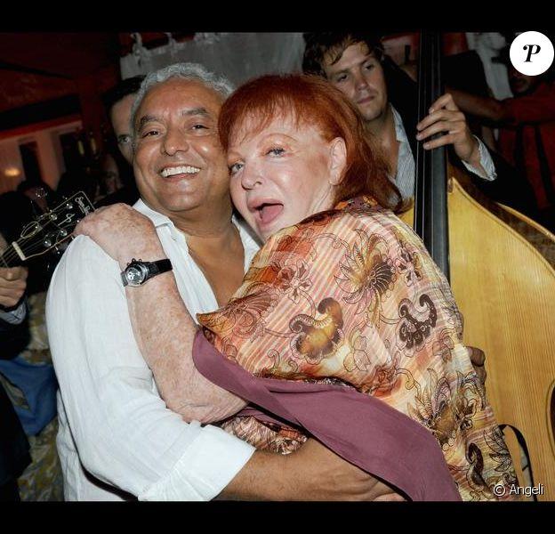 Régine et son ami François Bennaceur à l'anniversaire de Massimo Gargia et Monica Bacardi au Stefano Forever, à Saint-Tropez. 20/08/09