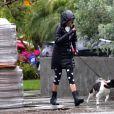 Exclusif - Nina Dobrev promène son chien Maverick sous la pluie près de sa maison de Los Angeles, pendant le confinement dû au coronavirus (Covid-19), le 9 avril 2020.