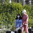 Laeticia Hallyday, ses filles Jade et Joy, Christina, avec des masques, et leurs chiens Santos, Cheyenne et Bono se promènent dans le quartier de Pacific Palisades, à Los Angeles, Californie, Etats-Unis, le 3 avril 2020, pendant la période de confinement.