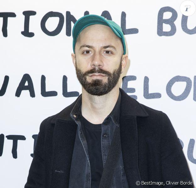 """Woodkid - Vernissage de l'artiste David Shrigley x La Maison Ruinart """"Unconventional Bubbles"""" à l'Opera Bastille à Paris le 5 mars 2020. © Olivier Borde/Bestimage"""
