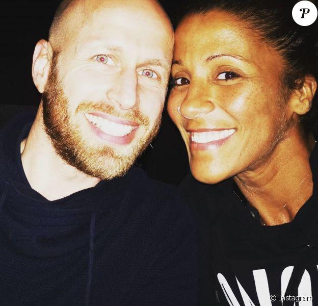 """Naoil, gagnante de """"Koh-Lanta, l'île des héros"""" (TF1), avec son mari Greg à son retour des îles Fidji en juin 2019."""