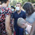 Exclusif - Le président Emmanuel Macron, masqué, prend un bain de foule à Bormes-les-Mimosas le 3 aout 2020. Il a ensuite pris un pot avec François Arizzi, le maire de la commune. © Jacovides/Moreau/Bestimage
