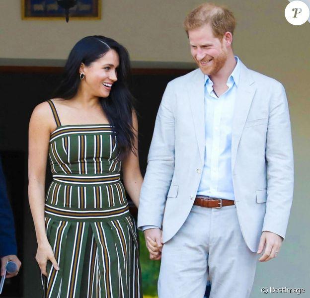 Le prince Harry, duc de Sussex, et Meghan Markle, duchesse de Sussex, lors d'une réception dans les jardins de la résidence du haut-commissaire britannique au Cap, Afrique du Sud.