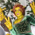 Heidi Klum et son compagnon Tom Kaulitz déguisés en Fiona et Shrek arrivent dans un carrosse à la soirée annuelle Halloween à New York, le 31 octobre 2018