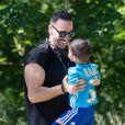 Adil Rami se promène avec son fils, Paris May 30, 2020.