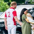 Meghan Markle, duchesse de Sussex et son fils Archie Harrison Mountbatten-Windsor lors d'un match de polo de bienfaisance King Power Royal Charity Polo Day à Wokinghan, comté de Berkshire, Royaume Uni, le 10 juillet 2019.