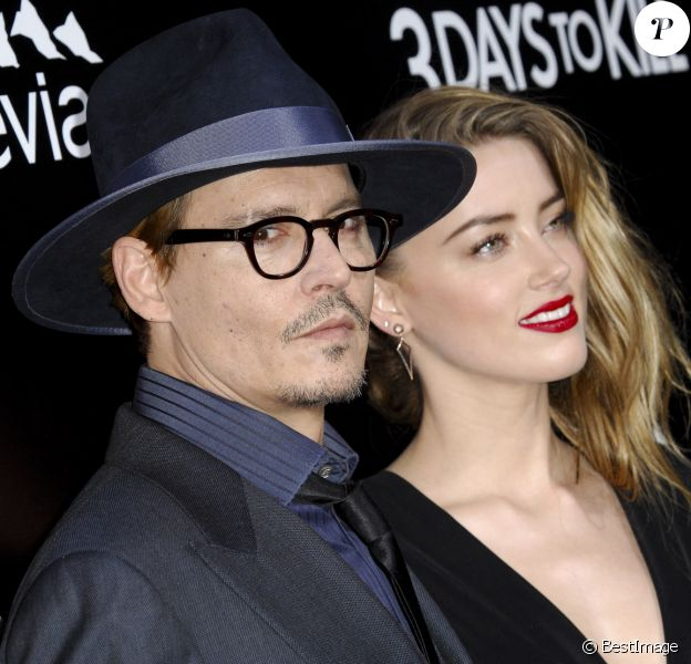 "Johnny Depp et sa fiancée Amber Heard - Première du film ""3 Days to Kill"" à Hollywood."