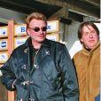 """Exclusif - Archives - Marc Francelet et Johnny Hallyday rendent visite au chef Marc Veyrat dans son restaurant """"La ferme de mon père"""" Megève."""