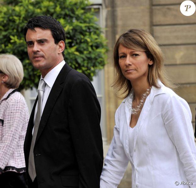 Manuel Valls et Anne Gravoin lors de la garden party de l'Elysée le 14 juillet 2009