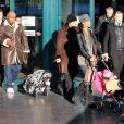 Mike Tyson à l'aéroport de Fiumicino en compagnie de sa femme Lakiha et de sa fille Milan, le 24 janvier 2010