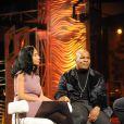 """Mike Tyson et sa femme Lakiha dans l'émission de télé italienne """"Sciock""""  au théâtre Videa à Rome, le 24 janvier 2010"""