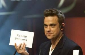 Regardez Robbie Williams, super classe, et Kesha, toujours plus trash, se mettre à la hauteur de Rihanna !