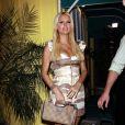 Paris Hilton sort dans un restaurant italien avec ses parents et son boyfriend Doug Reinhardt, pour l'anniversaire de sa maman Kathy, jeudi 11 mars, à West Hollywood.