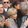 Colette, la veuve de Jean Ferrat aux obsèques de son mari à Antraigues-sur-Volane, Michel Drucker en arrière-plan