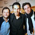 Jérémy Michalak, DJ Michaël Canitrot et Aurélien Combelles, à l'occasion de la présentation de son album  So Happy in Paris ? , dans un salon de la mairie du VIe arrondissement, à Paris, le 19 avril 2010.