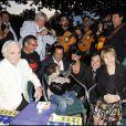 Charles Aznavour, Chico, Alessandra Sublet et Nathalie Delon lors de la soirée de solidarité Chico & les Gypsies au patio de Camargue afin de récolter des fonds pour la cause du don d'organes et celle de l'association Rêves le 28 mai 2010