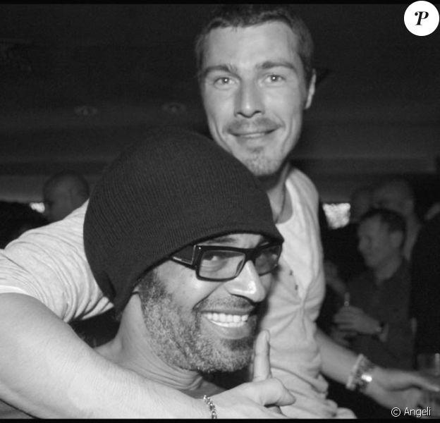 Yannick Noah et Marat Safin, lors d'une soirée à L'Arc, le 31 mai 2010.