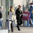 Johnny Hallyday, Laeticia et Jade et Joy arrivent à l'aéroport de Berne  en Suisse, le 3juin 2010 avec leur ami et parrain de Joy, Jean-Claud Darmon.