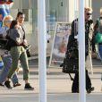 Johnny Hallyday, Laeticia et Jade et Joy arrivent à l'aéroport de Berne  en Suisse, le 3juin 2010 !