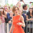 Cheryl Cole nous aura ravi avec sa jolie robe orange signée Versus divinement portée avec les sandales Bikki Pumps de chez Louboutin.