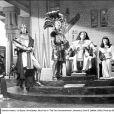 Charlton Heston Charlton Heston, Yul Brynner, Anne Baxter, Nina Foch dans Les Dix Commandements, de Cecil B. DeMille (1955)