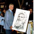 Charlton Heston, en 2001, lors de la première d'Harry Potter, reçoit un cadeau hommage...