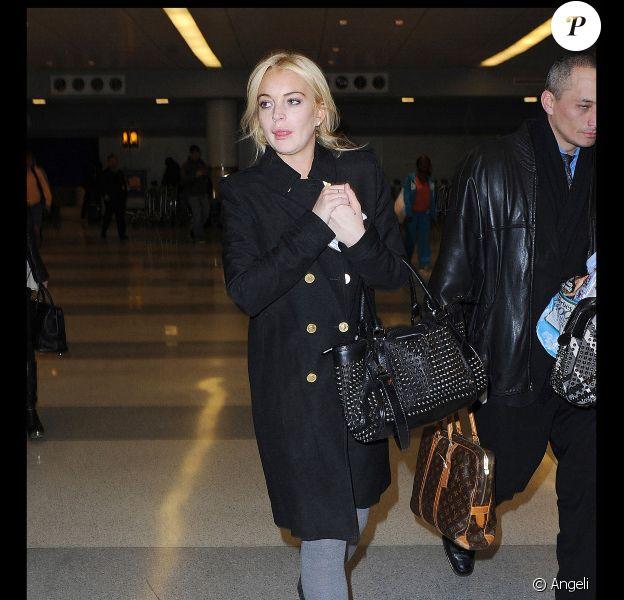 Lindsay Lohan, à l'aéroport JFK à New York, dimanche 13 mars.