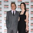 Gary Oldman et sa femme Alex Edenborough lors des Jameson Empire Film Awards, au Grosvenor House Hotel, à Londres, le 27 mars 2011.