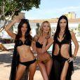 Candice Swanepoel lors de la présentation des maillots de l'été 2011 de Victoria's Secret entourée d'Adriana Lima et Alessandra Ambrosio. Elle affiche un corps très (trop) mince...