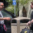 Johnny Hallyday rencontre son ami Christian Audigier à Los Angeles. 15 avril 2011