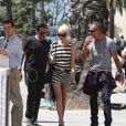 Johnny Hallyday, son épouse Laeticia, et leur ami Christian Audigier à Los Angeles. 15 avril 2011