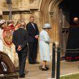 Les membres de la famille royale, protocole oblige, ont formé une haie d'honneur pour l'arrivée de la reine Elizabeth II et son époux le duc d'Edimbourg à la messe de Pâques donnée en la chapelle Saint-George à Windsor, le 24 avril 2011.