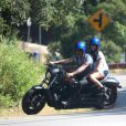 Christian Audigier en balade romatique en moto avec sa nouvelle petite amie Nathalie Sorensen, dans les canyons de Topanga, en Californie, le 4 mai 2011