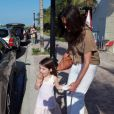 Katie Holmes et Suri s'offrent une petite balade à Miami, le 16 mai 2011
